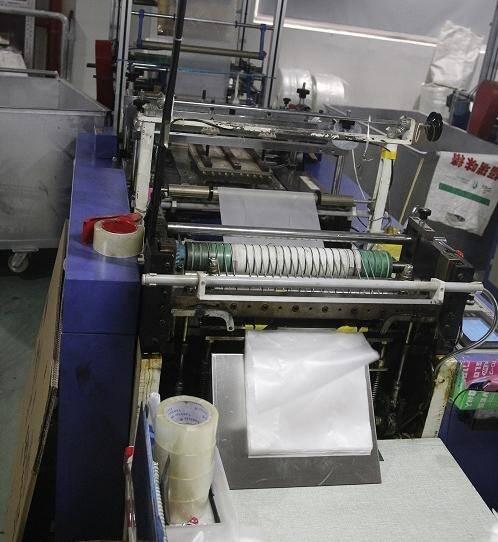 CPE GLOVE STAMPING MACHINE